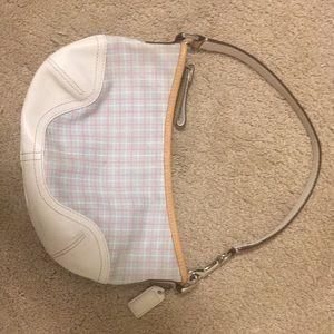 Coach's tiny purse